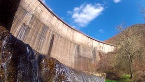 Dum flowing waters from hydro energy plant. Going underwater. Dum flowing waters from hydro energy plant stock footage