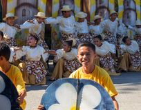 Dumaguete, Philippines - 16 September, 2017: Sandurot Festival of Dumaguete. Carnival with dancing. In colorful costumes. Smiling boy actor in street royalty free stock images