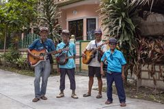 Dumaguete, the Philippines - 10 September 2018: street music players with ukulele or small guitar. Guitar and banjo players. Traveling musicians. Musical royalty free stock image