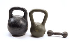 Dumb-bells. Isolated three different dumb-bells Royalty Free Stock Photos