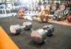 Dumb bells. In gym room, close up horizontal photo Royalty Free Stock Photos
