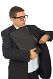 Dumb business man put laptop in jacket Royalty Free Stock Photo
