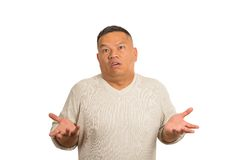 Dumb clueless man arms out asking why what's problem who cares stock photography
