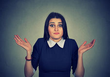 Dumb looking woman arms out shrugs shoulders I don't know royalty free stock photos