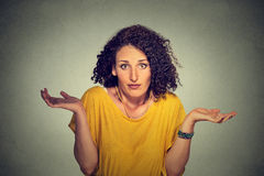 Dumb looking woman arms out shrugs shoulders who cares so what Royalty Free Stock Images