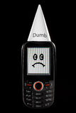 Dumb Phone With Sad Face And Dunce Hat Stock Photos