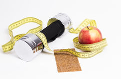 Dumbbel apple and measure tape Stock Images
