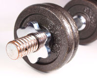 Dumbbell. Macro photo of dumbbell isolated on white royalty free stock images