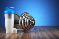 Dumbbell And Whey Protein Shaker. Sports Bodybuilding Supplement Royalty Free Stock Photo