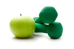 Dumbbell with an apple Royalty Free Stock Photo
