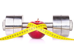 Dumbbell and an apple Stock Image