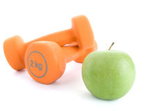 Dumbbell and an apple Royalty Free Stock Images