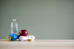 Dumbbell and apple Royalty Free Stock Photos