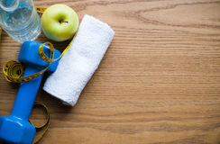 Dumbbell and apple Stock Photos