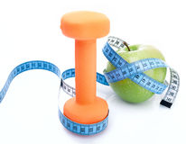 Dumbbell with apple and measure tape Stock Photography