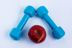 Dumbbell and apple white background sport Royalty Free Stock Images