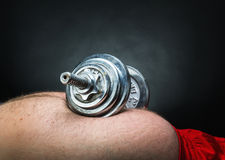 Dumbbell on the belly Stock Image