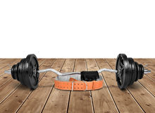 Dumbbell with belt and gloves Royalty Free Stock Photo