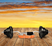 Dumbbell with belt and gloves Royalty Free Stock Image