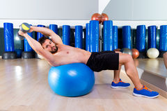 Dumbbell bench press on fit ball man gym workout Royalty Free Stock Photography