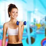 Dumbbell bicep curl by a fitness girl Stock Images