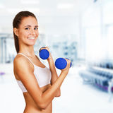 Dumbbell bicep curl by a fitness girl. Sporting life Stock Images