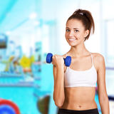 Dumbbell bicep curl by a fitness girl. Sporting life Stock Photos