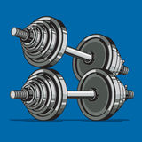 Dumbbell on blue background. Stock Photo