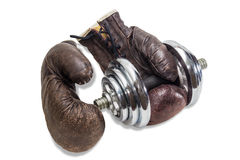 Dumbbell and boxing gloves Stock Photo