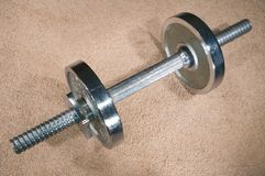 Dumbbell on carpet. Royalty Free Stock Photography