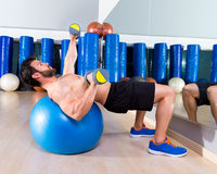 Dumbbell chest press on fit ball man workout Stock Images