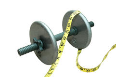 Dumbbell con nastro adesivo di misurazione Fotografia Stock