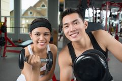 Dumbbell couple Stock Photos