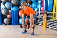 Dumbbell deadlift blond man at gym weightlifting Stock Photos