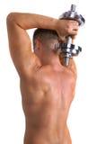 Dumbbell della holding del Bodybuilder immagine stock