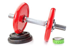 Dumbbell on disk and tape measure meter. For fitness. Stock Image