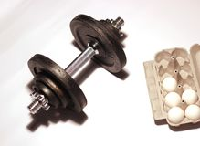 Dumbbell And Eggs Royalty Free Stock Photos