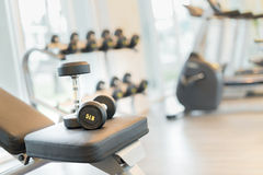 Dumbbell on the exercise bench. Two dumbbells on the exercise bench. Gym equipment Royalty Free Stock Images