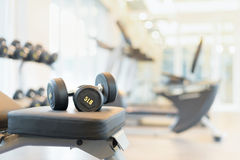 Dumbbell on the exercise bench. Two dumbbells on the exercise bench. Gym equipment Stock Photos