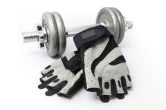 Dumbbell and Fitness Gloves on white background Royalty Free Stock Image