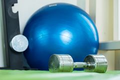 Dumbbell on the floor in the fitness room. Royalty Free Stock Images