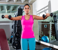 Dumbbell front shoulder flies fly woman workout Stock Photo