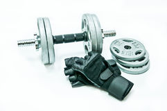 Dumbbell and glove Royalty Free Stock Image