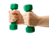 Dumbbell in hand Stock Images