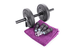 Dumbbell, hand grips and a towel Royalty Free Stock Photography