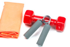 Dumbbell, hand trainer and towel, isolated Royalty Free Stock Photography