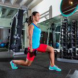 Dumbbell lunge woman exercise at gym Royalty Free Stock Photo