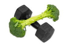 Dumbbell made of Broccoli on white background. stock photo