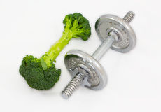 Dumbbell made of Broccoli on white background. Stock Images