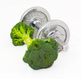 Dumbbell made of Broccoli on white background. Stock Image